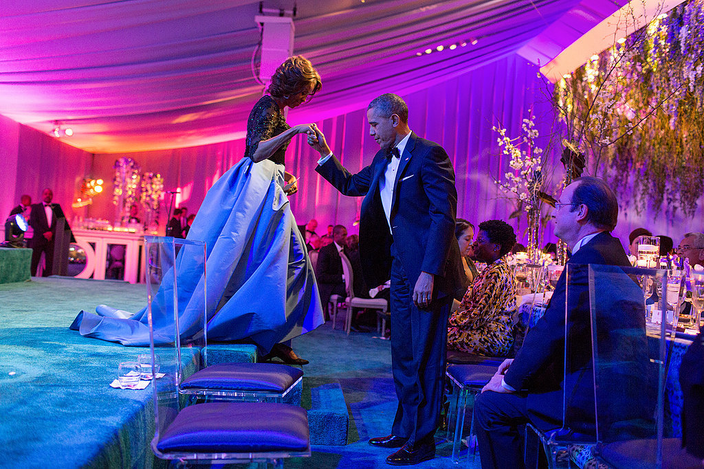 President Obama helped First Lady Michelle Obama off the stage during the State Dinner for President Francois Hollande of France in February.