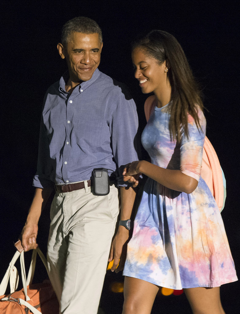 Malia laughed alongsider her dad when they returned from their trip to Martha's Vineyard in August.