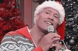 The Rock Singing Christmas Karaoke In A Festive Onesie Is All You Need Today