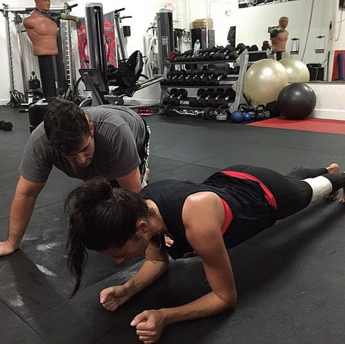 It looks like planks are one of the secrets to model Adriana Lima's abs!