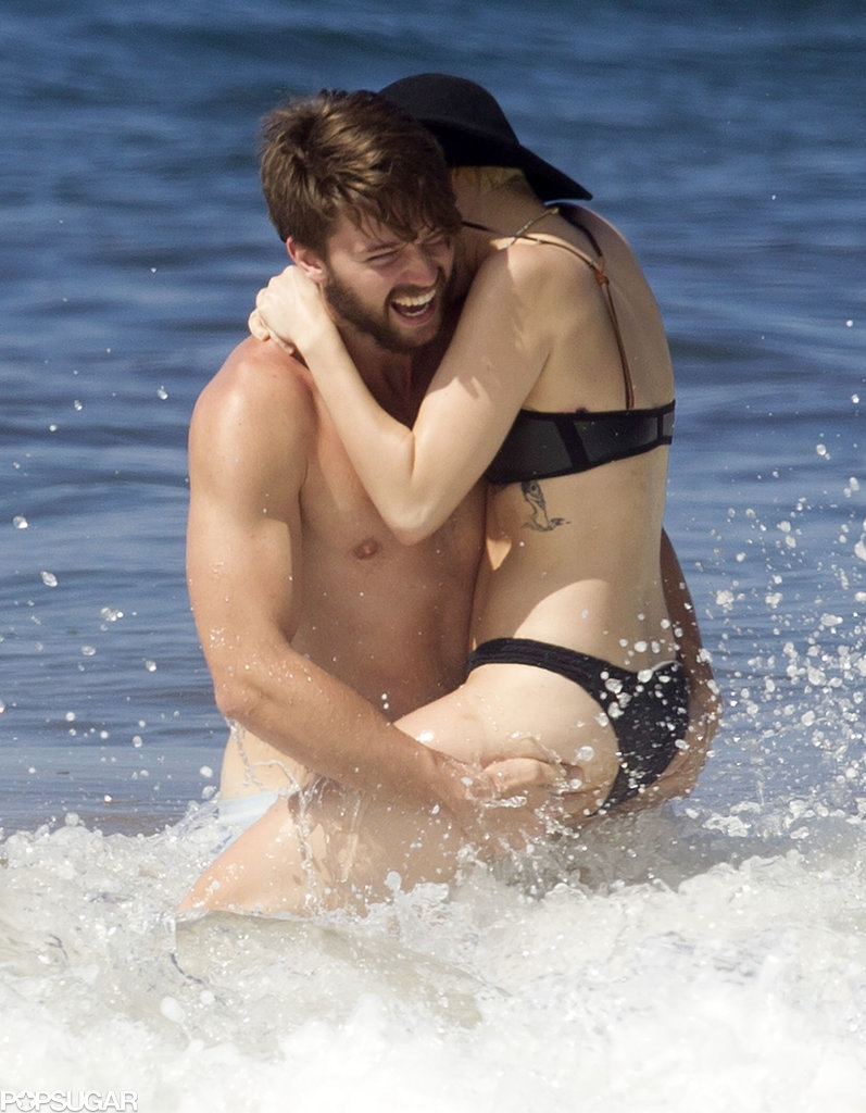 Miley Cyrus and Patrick Schwarzenegger made a sexy splash in Hawaii in January 2015.