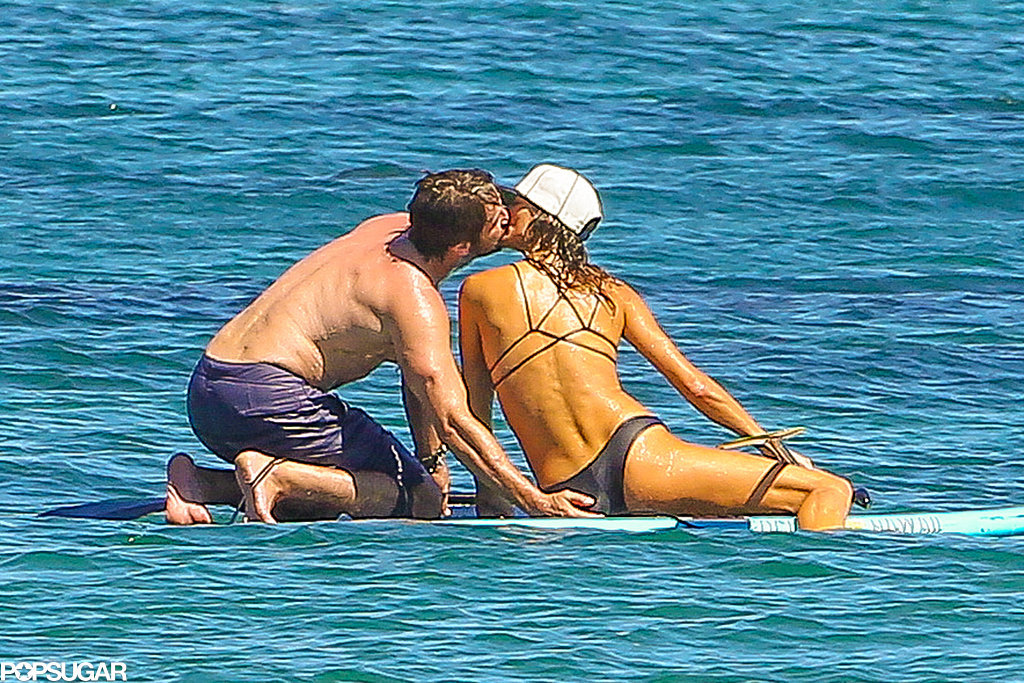 Gerard Butler grabbed a handful of his girlfriend's butt while out paddle boarding in Malibu, CA in September 2014.