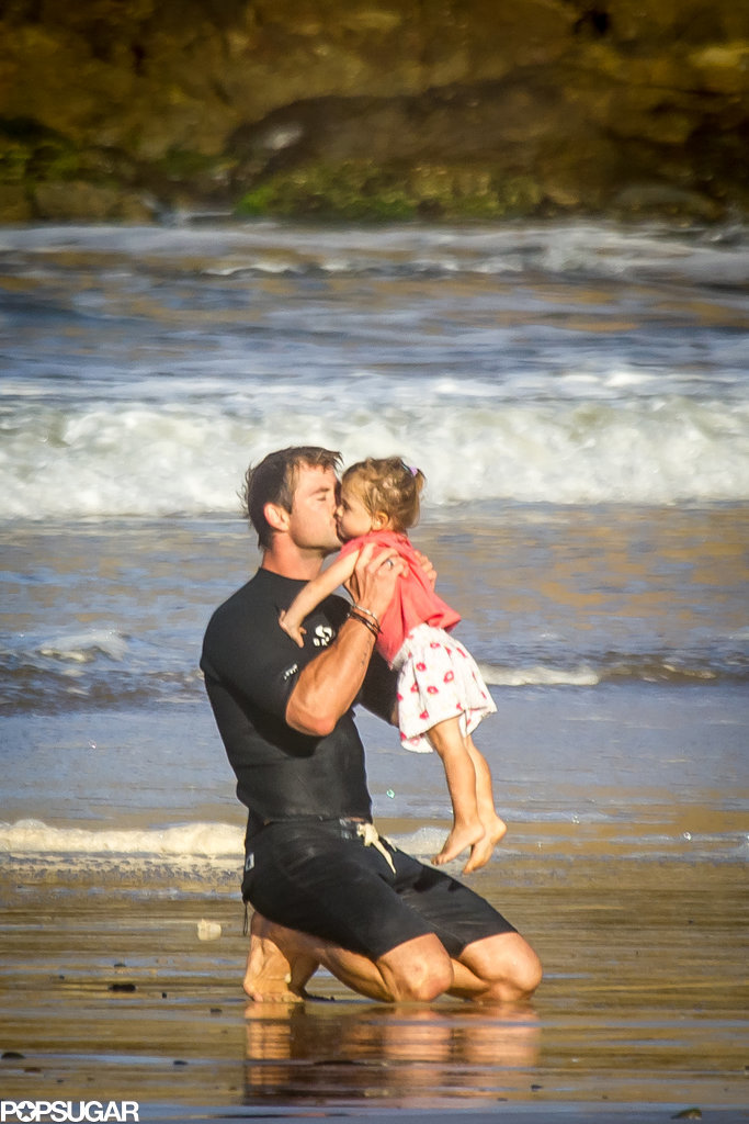In March, Elsa shared this sweet photo of Chris with their daughter on Instagram after it was snapped during a family beach day.