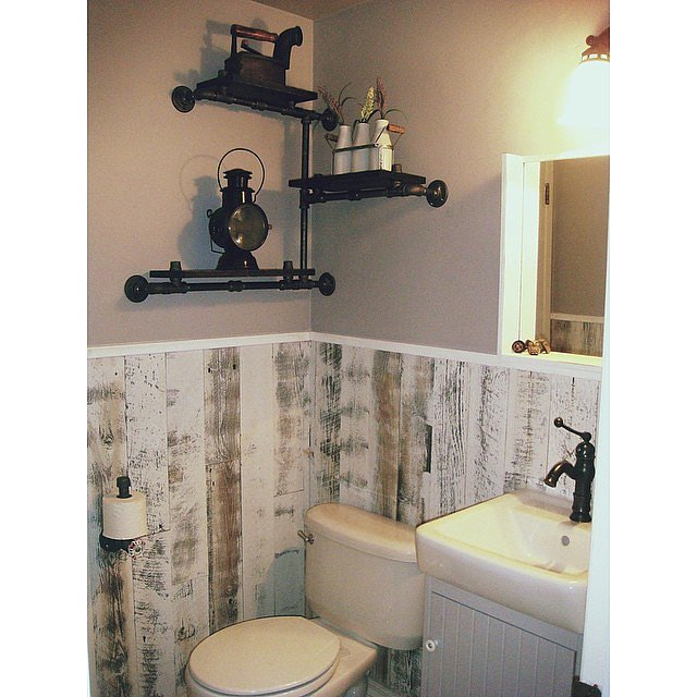 Vertically laid peel and stick wood panels take the place for Bathroom decor panels