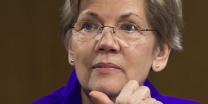 Upset By Elizabeth Warren, U.S. Banks Debate Halting Some Campaign Donations