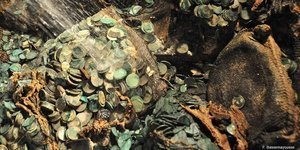 A British crew recovered £34 million worth of silver coins at a world record depth