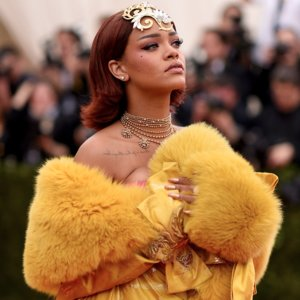 Pictures of Rihanna in Yellow Guo Pei Dress at 2015 Met Gala