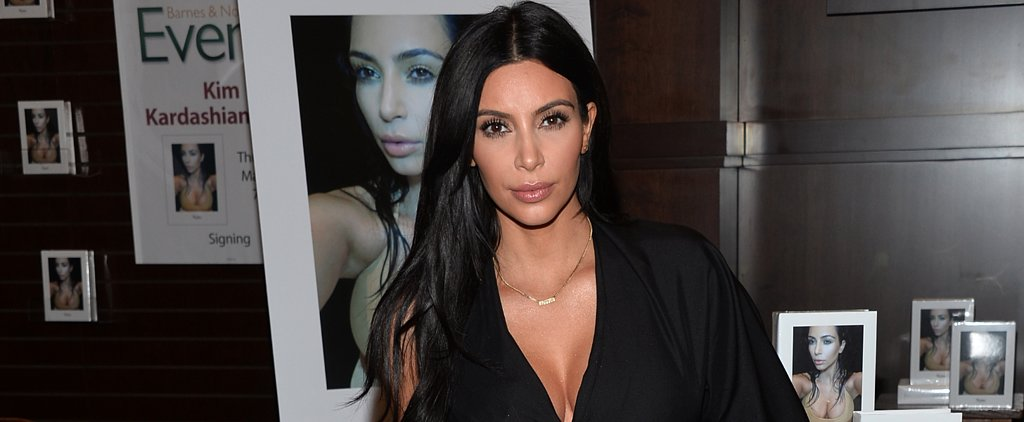 Kim Kardashian Sports Cleavage For Charity