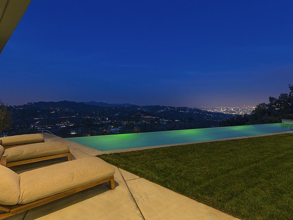the infinity pool looks almost magical at night inside. Black Bedroom Furniture Sets. Home Design Ideas