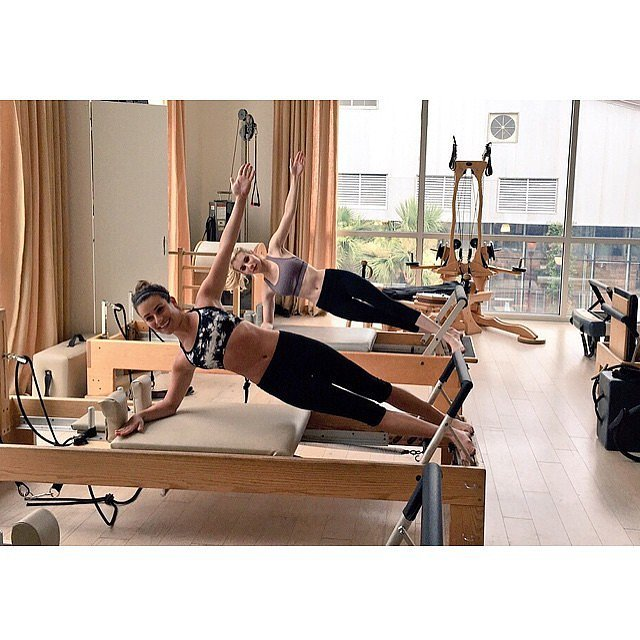Lea Michele smiled through this tough workout on the reformer.