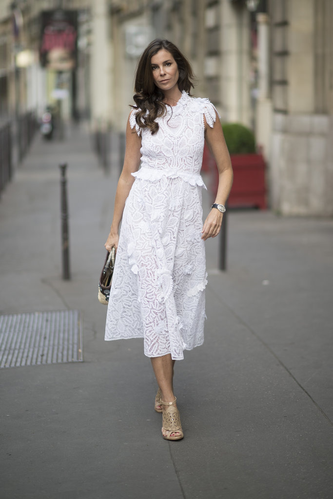 Lacey floral details take this white dress to the next level.