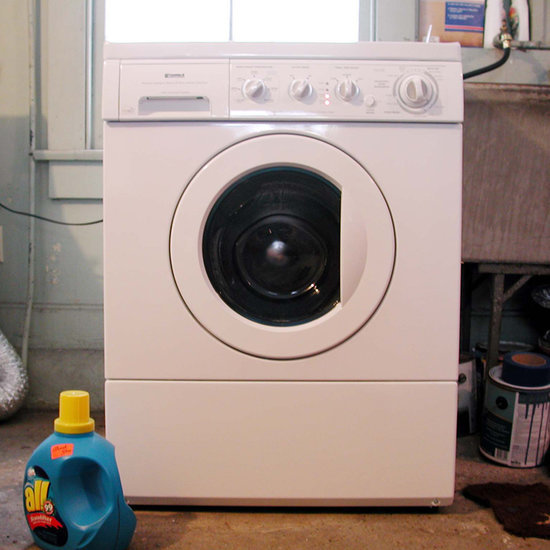 Mother Takes a Photo of Her Child in a Washing Machine