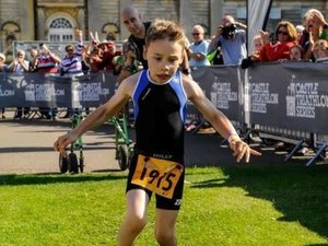 Watch Boy With Cerebral Palsy Cast Aside Walking Aid And Finish A Triathlon Like The Champ He Is