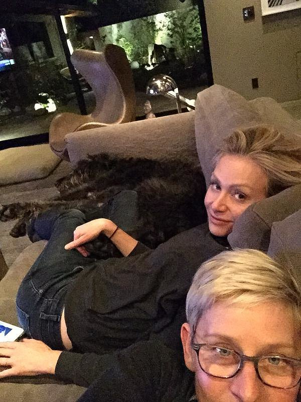 The duo cuddled up on the couch with their dog in April 2014.