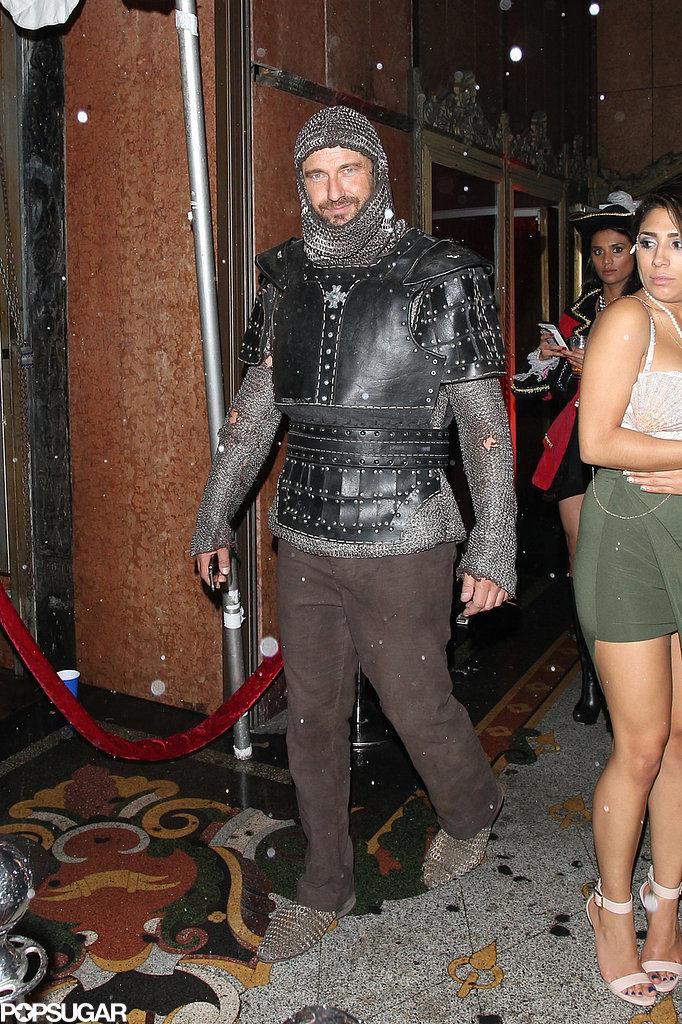 Gerard Butler attended the Treats Magazine Halloween Party as a knight in LA in 2014.