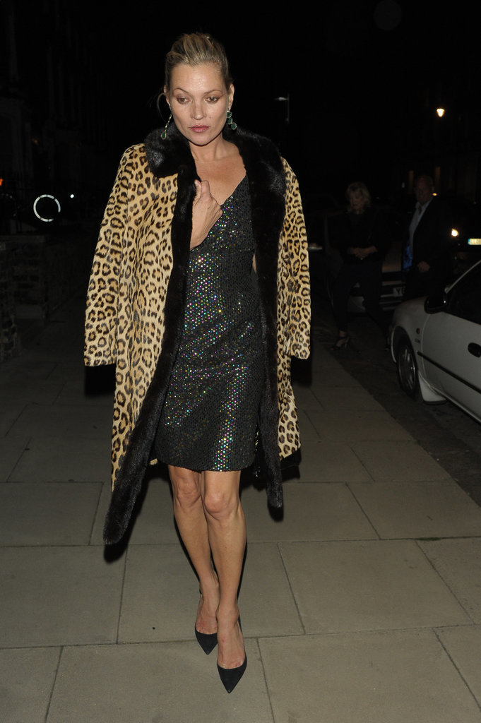 Kate covered her rainbow-sequined tank dress with a luxe leopard coat.