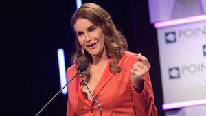 Caitlyn Jenner Stuns in Red Pantsuit and Lacy Bra at Charity Event, Reunites With Another Groundbreaking Olympian