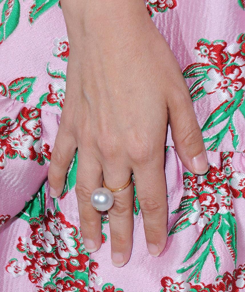 Rachel's single pearl earrings definitely popped against her dress, playing up the design's sheen.