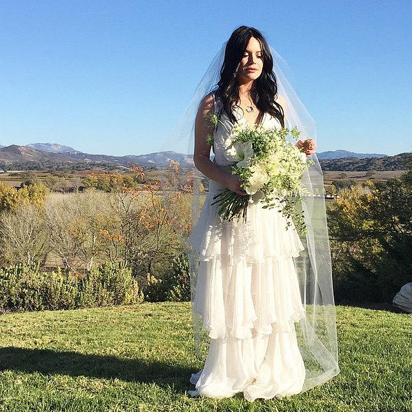 The bride, celebrity stylist and fashion designer of Elkin, Kara Elkin, wore a tiered white Fall '16 Houghton gown.