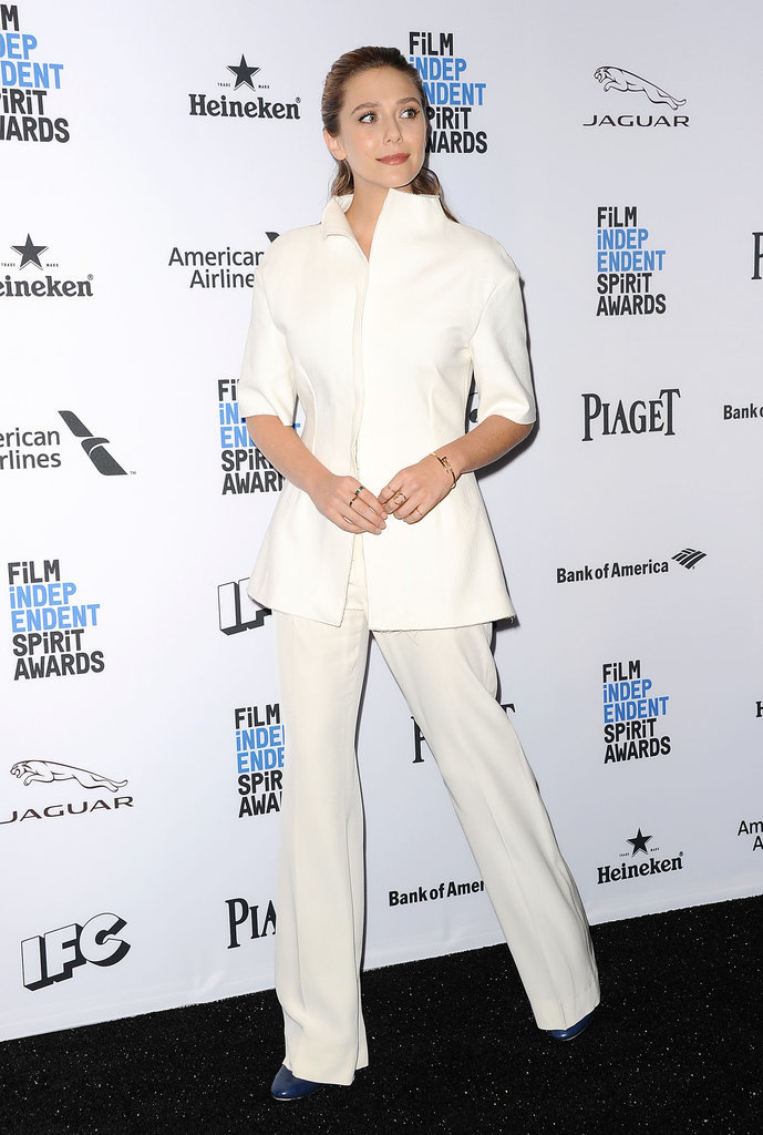 Elizabeth anchored her cream coordinates with navy-blue patent-leather shoes.