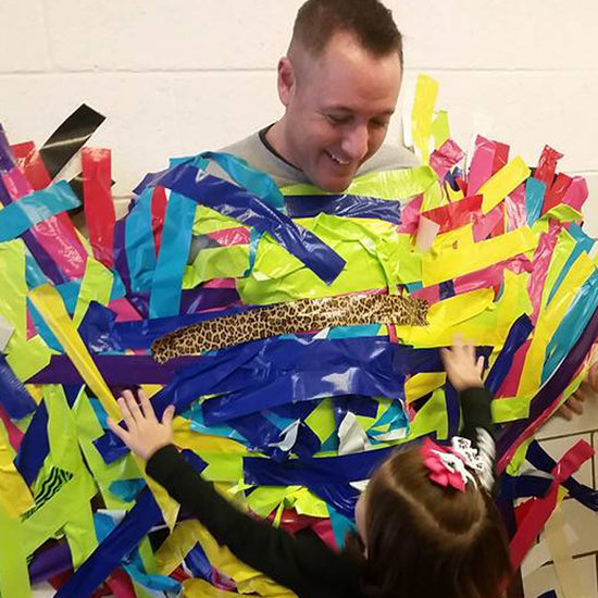 School Principal Duct Taped to Wall For Charity