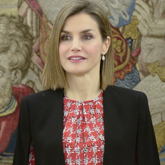 Queen Letizia Wears Chic Cape Look in Madrid