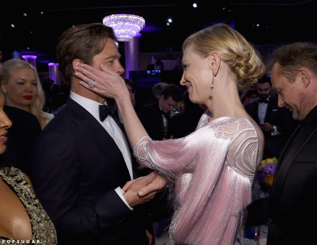 Cate Blanchett held Brad Pitt's face in her hands as they caught up after the show.