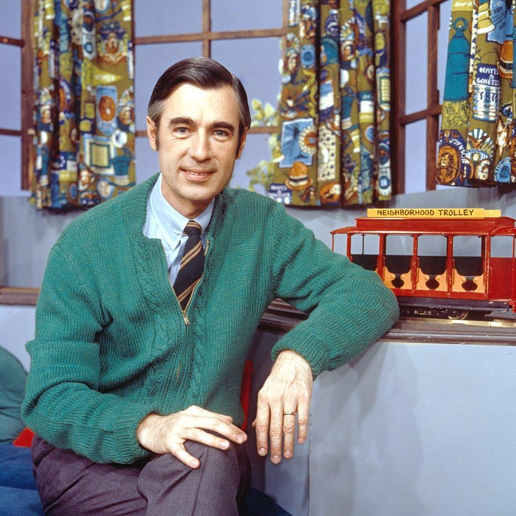 Mister Rogers rocks a green sweater.