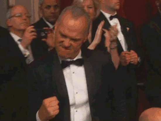 A Very Excited Michael Keaton Fist Pumps His Way to Stage After Spotlight Wins Best Picture at the Oscars