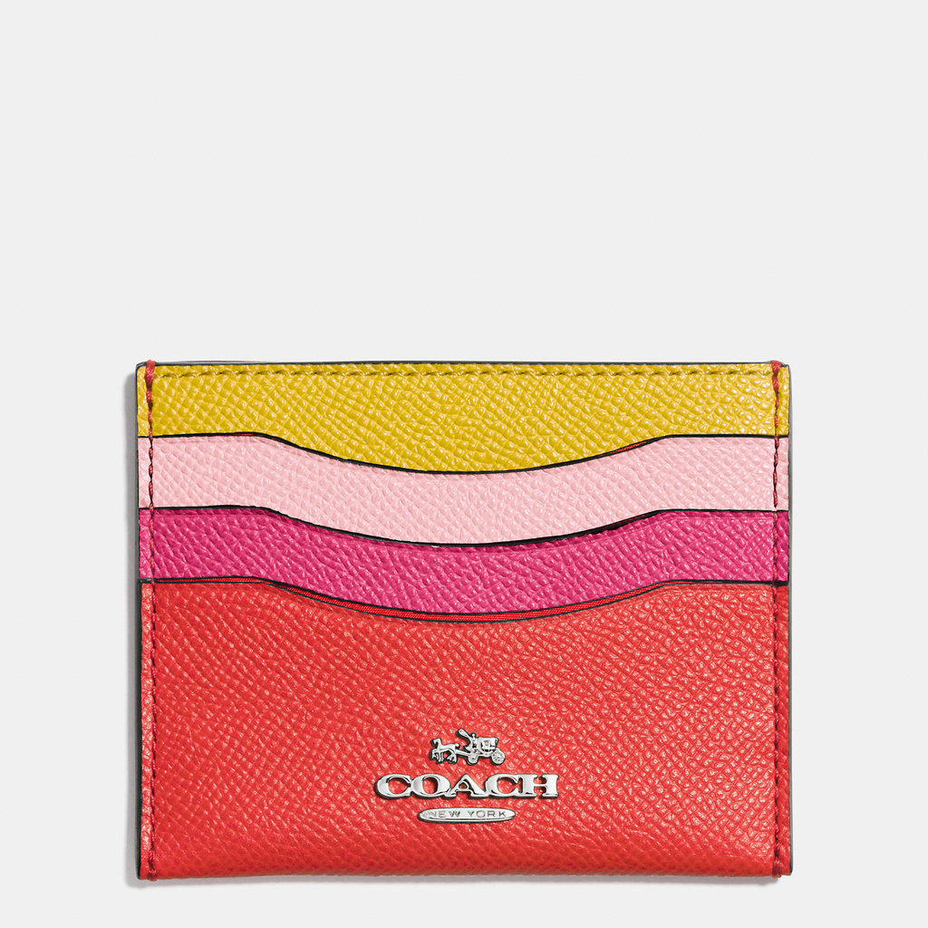 This sunny card case will help mom streamline on the go — plus the bright pop of color will make her smile.  Coach Colorblocked Leather Card Case ($45)