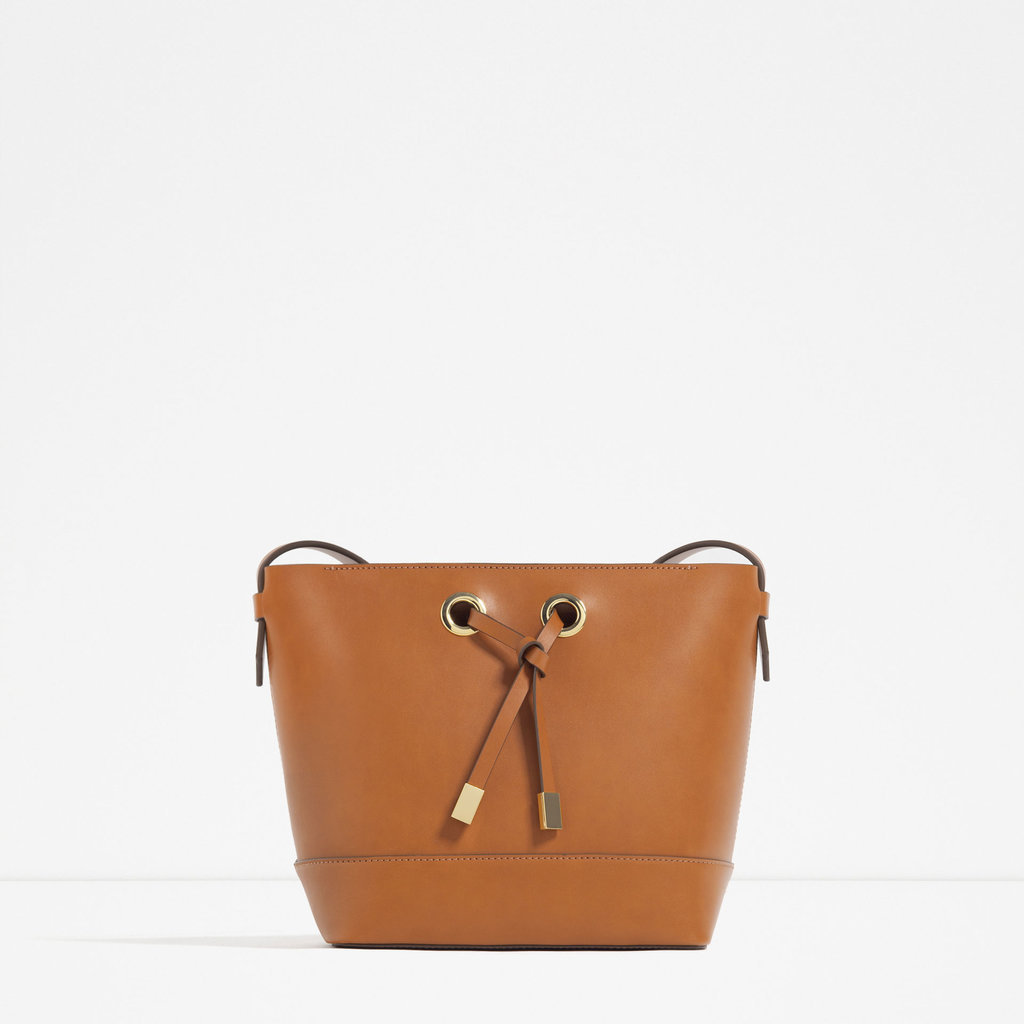This easy bag works just as well during the workweek as it does for a beachy getaway — just the kind of versatile bag moms love. Zara Cross Body Bag with Gold Hardware ($40)