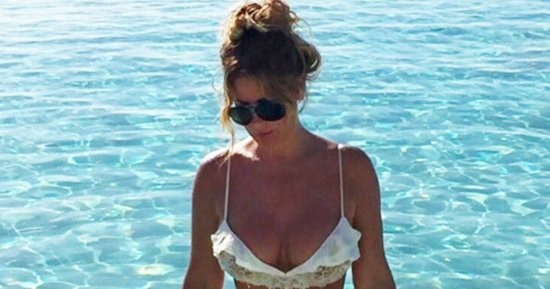 Kim Zolciak Wears Barely There Bikini on Surprise Vacation with Husband