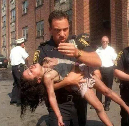 Police Officer Reunites With Girl He Saves at Her Graduation