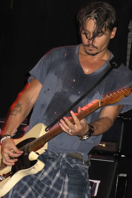Photo of Johnny Depp Playing Guitar Plus Rumours He Will Play Guitar With British Band Babybird in November