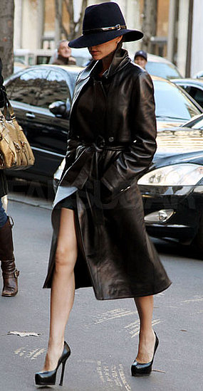 Photo of Victoria Beckham Wearing Black Leather Trench Coat in Paris