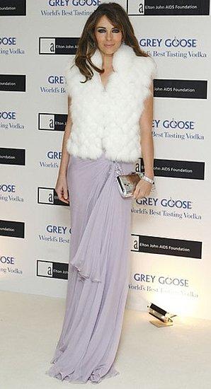 Photo of Elizabeth Hurley Wearing Lavender Dress and White Fur Vest at Grey Goose Vodka Fundraiser in London