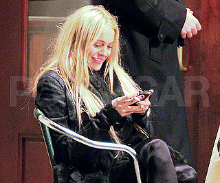 Slide Photo of Lindsay Lohan On Her Blackberry At Lunch in NYC