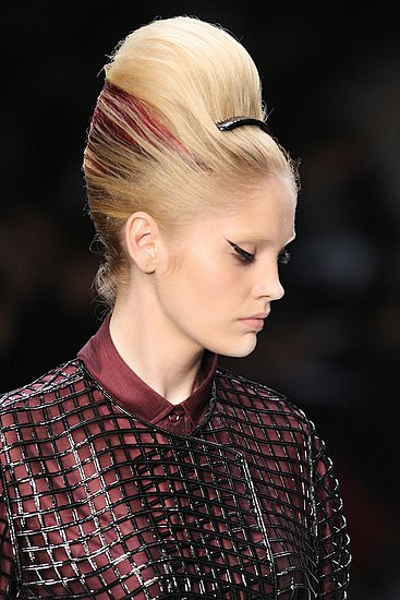 "Makeup: YSL did ""Fellini eyes"" but it wasn't the only time we saw dramatic liner on catwalk lids."