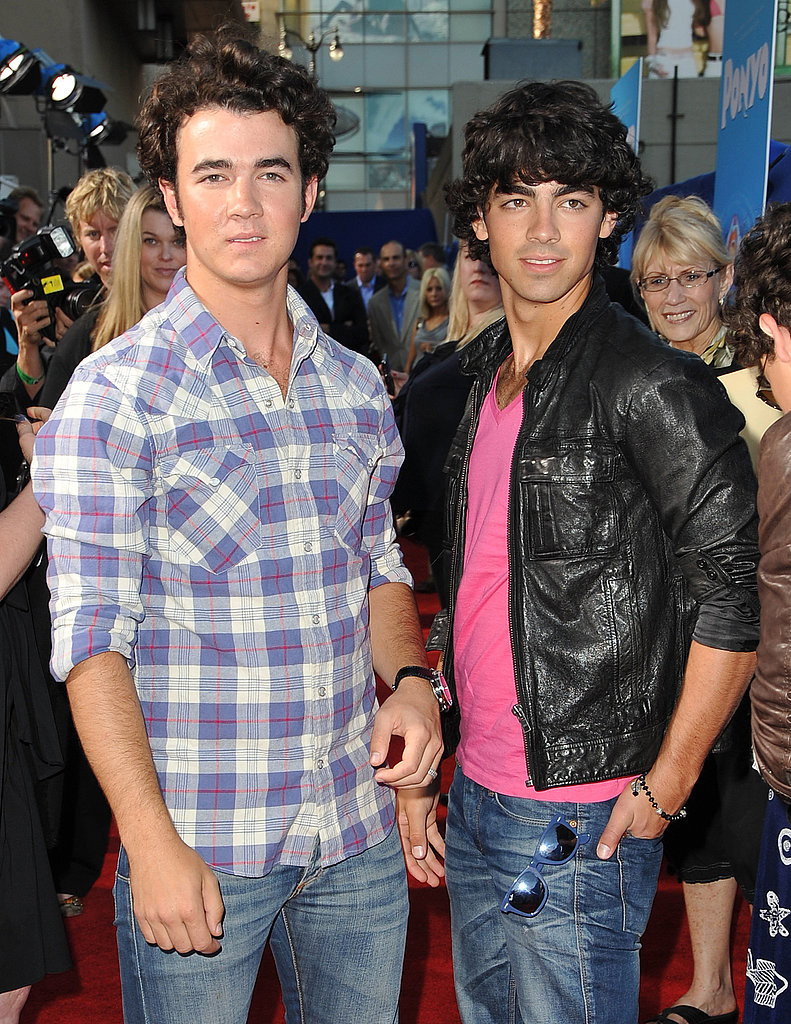 Photos of the Jonas Brothers with Bonus Jonas