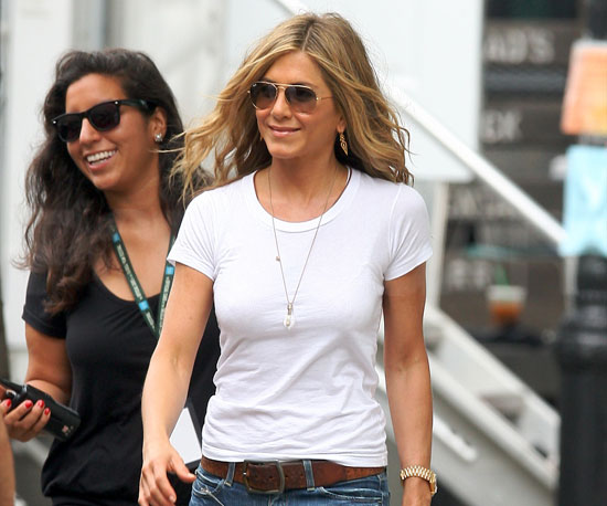 Slide Photo of Jennifer Aniston Walking Around The Bounty Set Smiling in White Shirt and Jeans