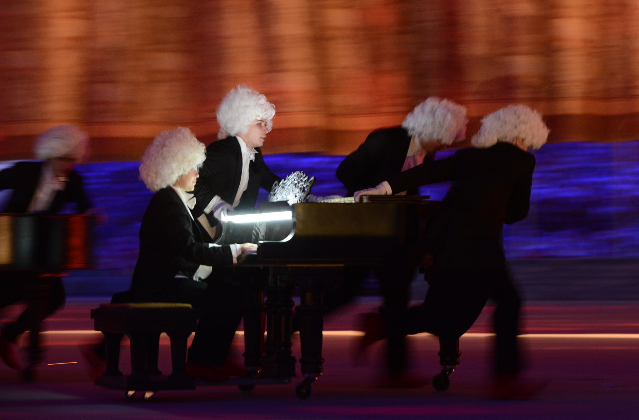 Dancers pulled pianos into the center of the stadium for Russian pianist Denis Matsuev's performance.