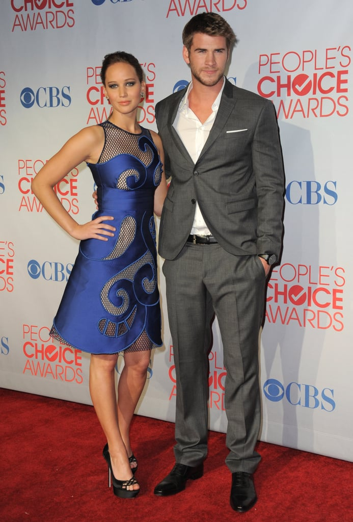Jennifer Lawrence and her costar Liam Hemsworth started promoting at the People's Choice Awards in January.