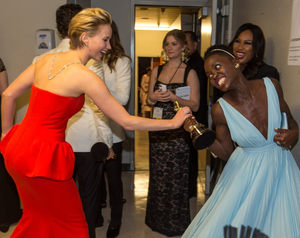 Jennifer Lawrence and Lupita Nyong'o — who were nominated together in the best supporting actress category at Sunday's Academy Awards — staged an adorable fight over the trophy.