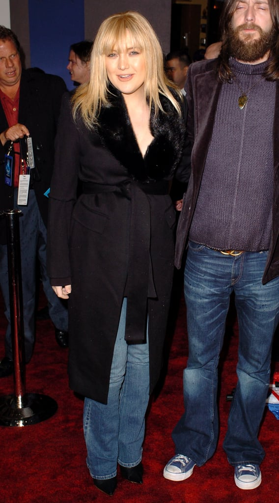 Kate Hudson kept the bump cozy in a Wintery, fur-collared coat with then-hubby Chris Robinson.