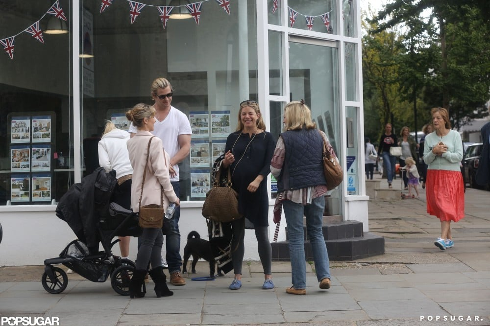 Sienna Miller chatted with Chris Hemsworth and his wife Elsa Pataky as they took a walk with their baby India in London.