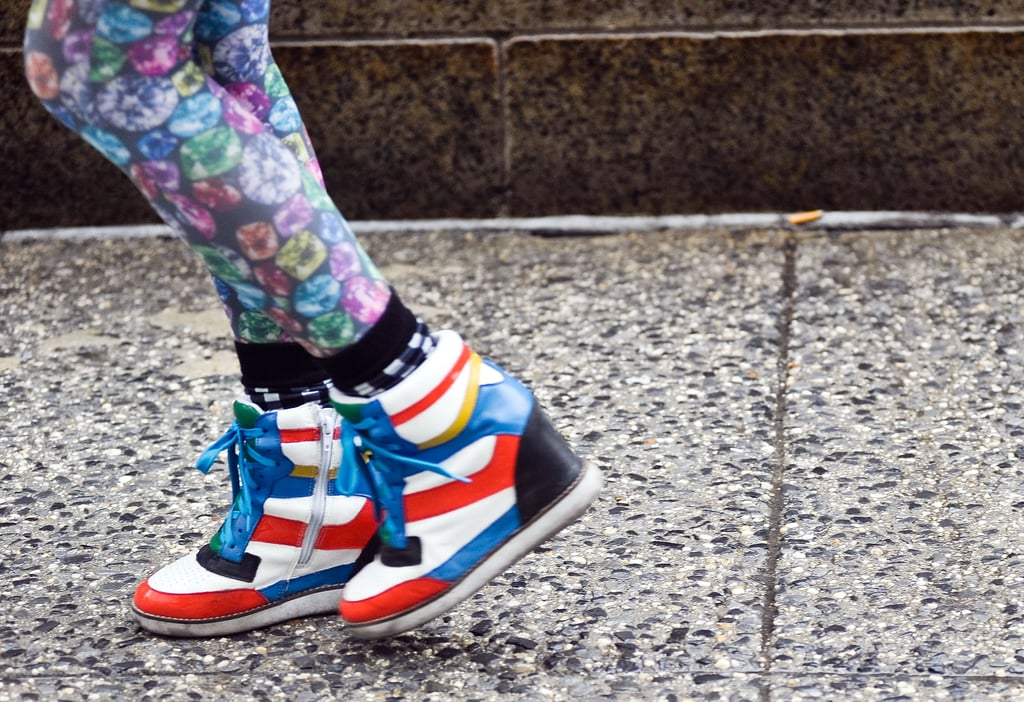 A pair of bold striped high-tops added another printed dimension to floral-print legwear.