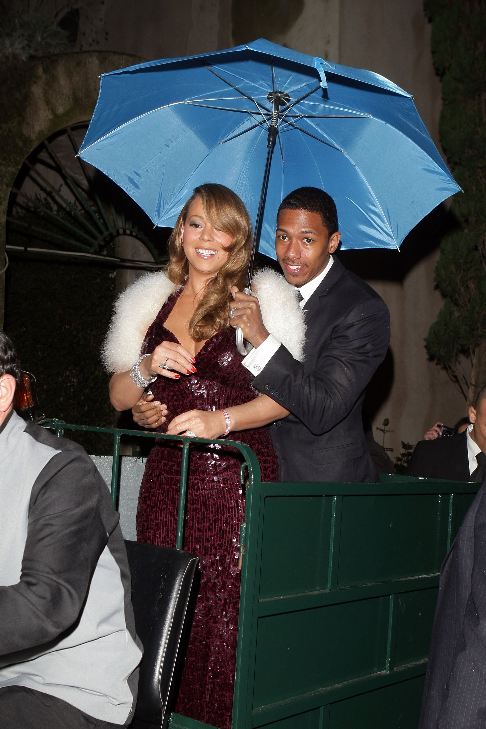 Nick Cannon covered Mariah Carey from the rain while in Italy at the 2009 International Film Festival.