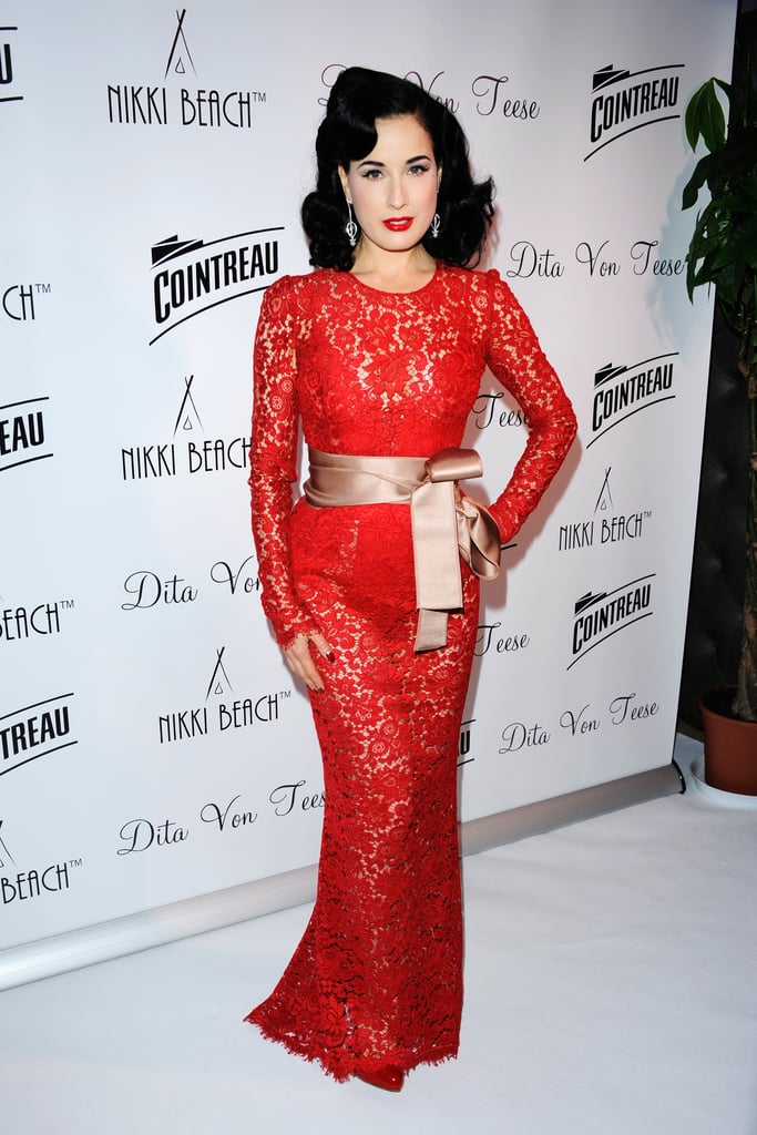 Dita Von Teese stunned in a red lace Dolce & Gabbana gown at the Cointreau party at Cannes.