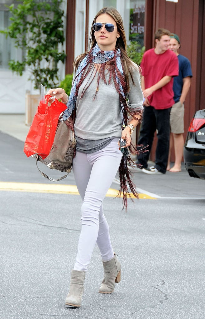 Alessandra Ambrosio shopped at Brentwood Country Mart in an eclectic pairing, which included a fringed scarf and lavender Black Orchid jeans.