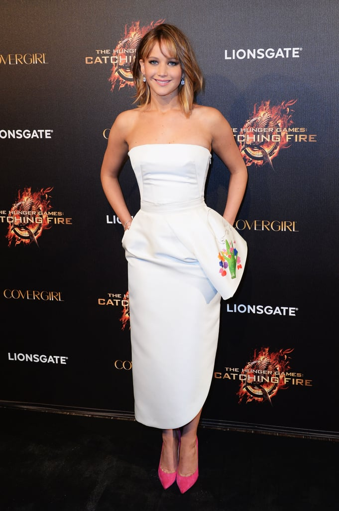 At The Hunger Games: Catching Fire party in Cannes, Jennifer Lawrence exuded freshness in a strapless white Dior dress with an asymmetrical peplum and hot-pink pumps.